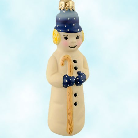 Vaillancourt lady snowman wears white polka dot hat & mittens & yellow ear muffs as she walks with a cane.